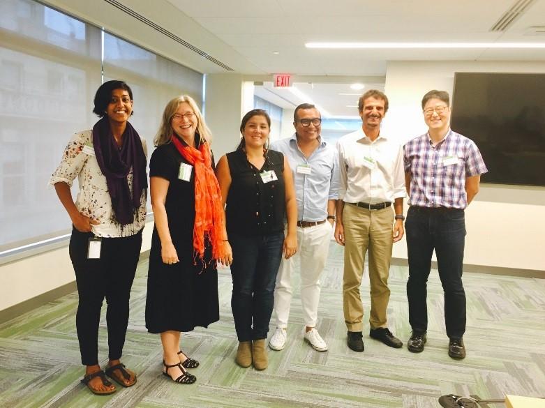 Ruth Meinzen-Dick, Jawoo Koo and Carlo Azzarri with the three Datathon winners: Adan Silverio Murillo, Angela Garcia, and Naziha Sultana